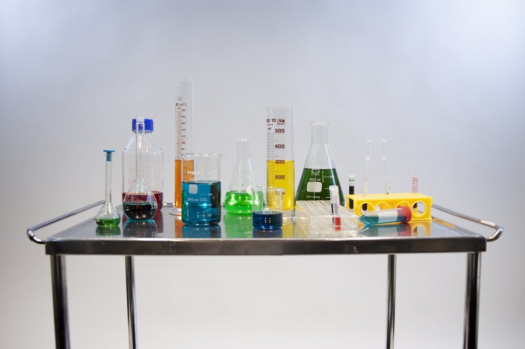 A metal cart with lab beakers of various sizes and shapes.