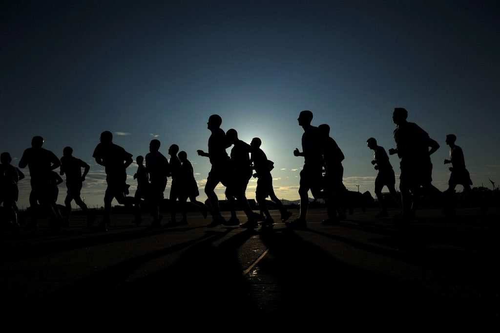 Silhouette of runners in a marathon.