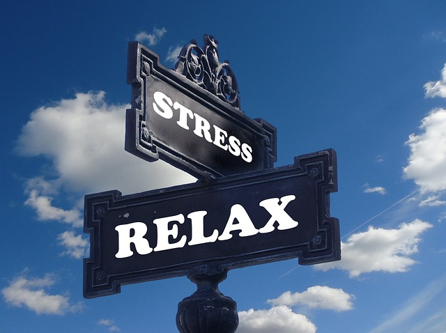 """Stress"" and ""Relax"" as criss-crossed black street signs."