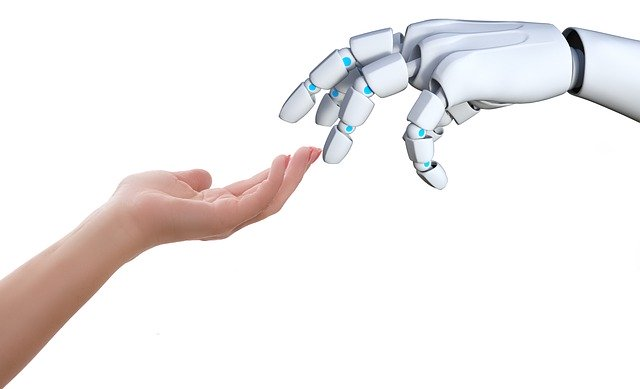 The a human hand and a robot hand.