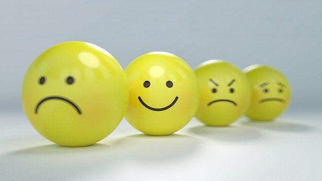4 yellow balls with different emotions on the front.